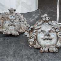 Two lead masks Louis XIV