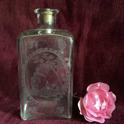 Bottle in molded blown glass with finely engraved decoration, for perfume or for rose water