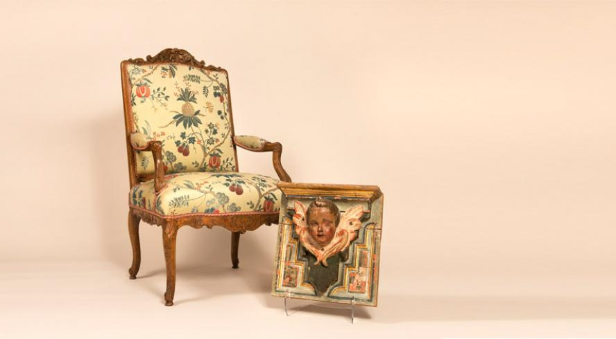 Pair of armchairs and angel head eighteenth century