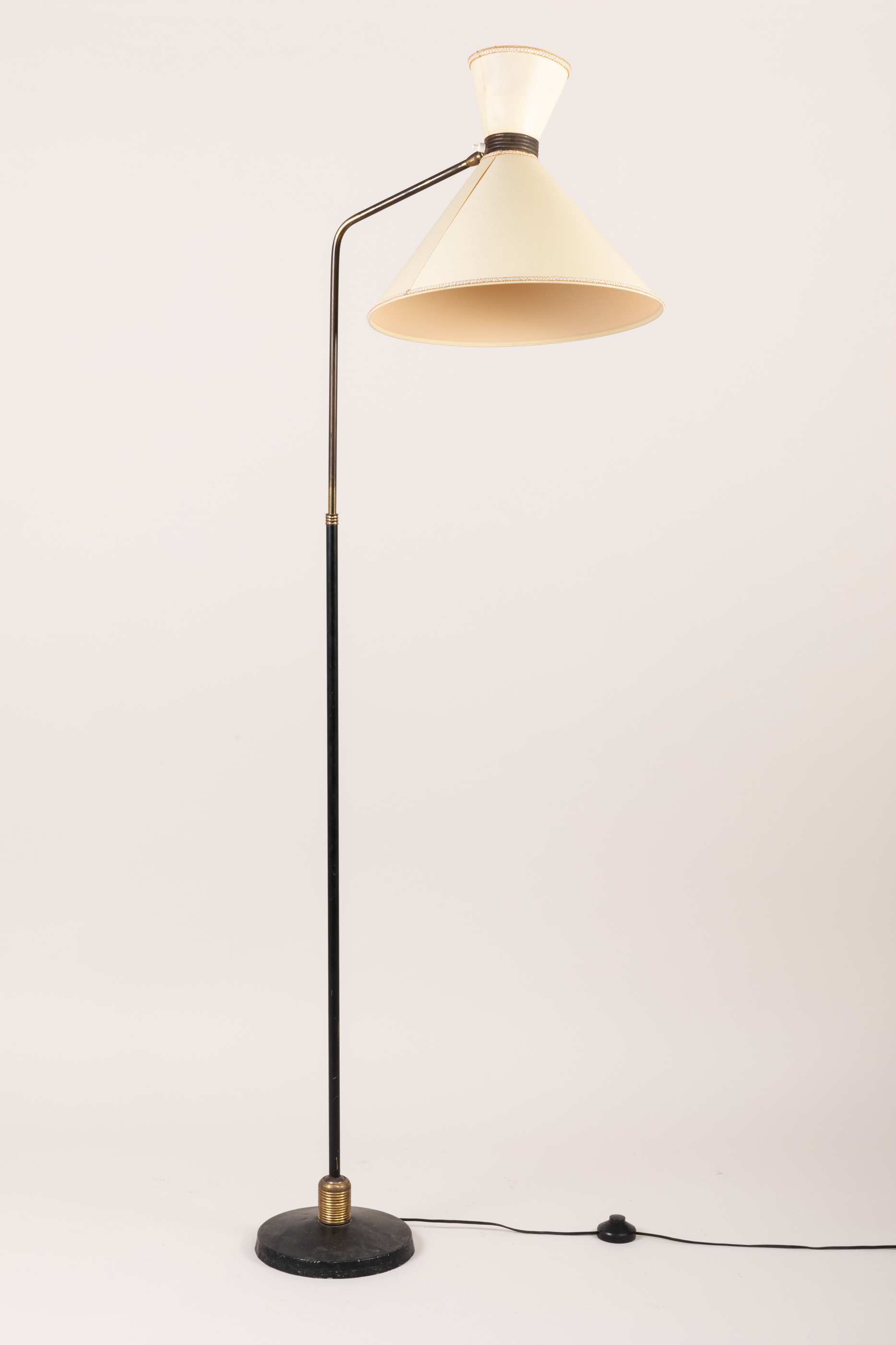 floor lamp in black metal and gilded brass with original double conical shade circa 1950 paul bert serpette