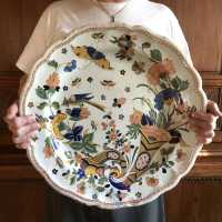 Very large dish of Malicorne, earthenware of Sarthe, polychrome decoration in the so-called Rouen way, cornucopia overflowing with foliaged flowers, bird of paradise and butterfly