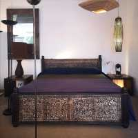 Carved exotic wood bed