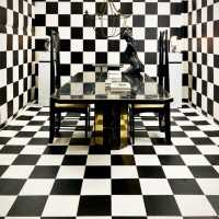 Table designed by Paco Rabanne in black portor marble and brass
