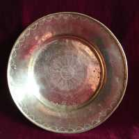 Circular brass dish XVIIIth, offering dish, quest dish, with central decoration of a radiant anthropomorphic sun