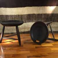 Sergio Rodrigues (1927-2014) Banco Mocho Pair of tripod stools Ebony lacquered rosewood
