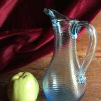 Elegant Norman pitcher, of slender shape, in blue blown glass