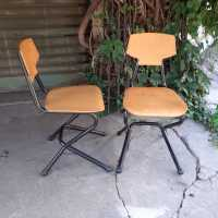 pair of wood and metal chairs