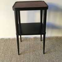 Elegant pedestal table in blackened wood and upper tray in red leather