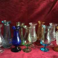 Interesting collection of 10 flower / floral vases (rarely presented for sale as a set), in glass of different colors, some engraved