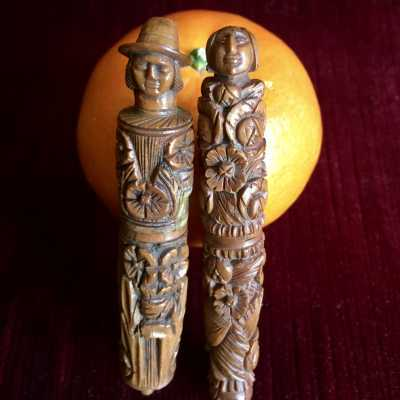 "Pair of anthropomorphic needle cases, ""Man and Woman"", very finely carved in corozo nuts"